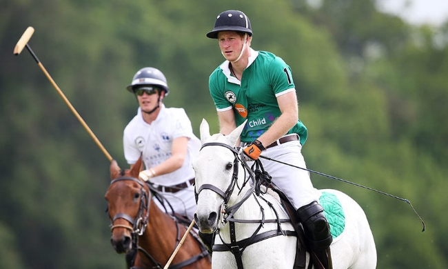 Prince Harry playing in the Maserati Jerudong Park Trophy match at the Cirencester Park Polo Club.