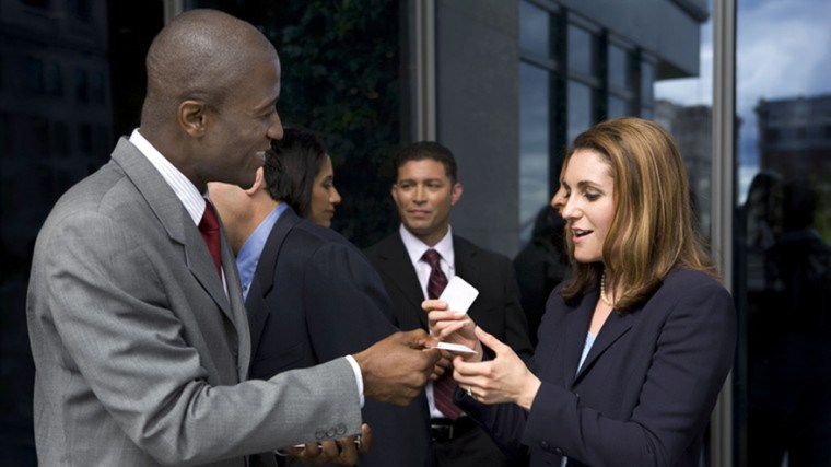 exchanging-business-cards-black-man-and-white-woman-gettyimages-Diane-Diederich.jpg