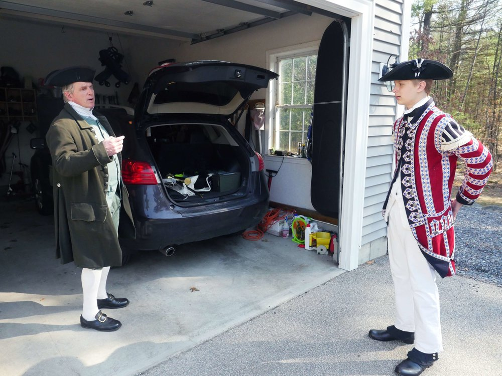 "Bolton, MA - April 14th, 2018 - Hannes and Gavin Klein load up the car before setting out to the Battle of Lexington and Concord reenactments in Minuteman National Park. Although Hannes Klein enjoys reenacting the battles he said cars are ""a lot better than horse and carriage."""