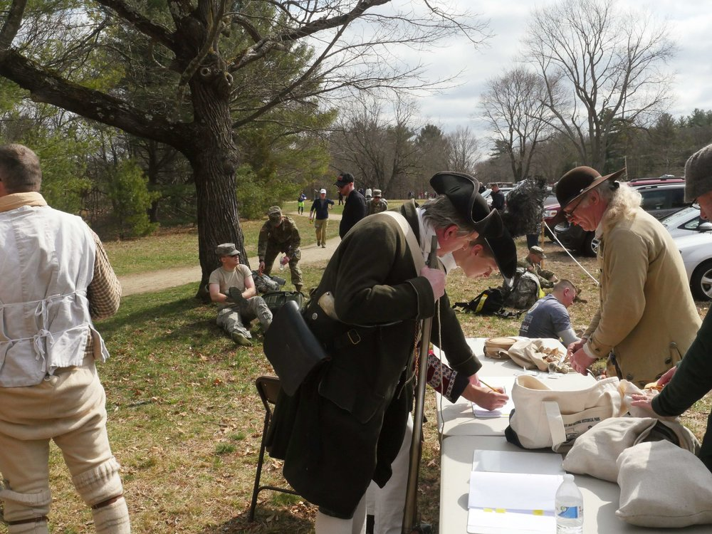 "Lincoln, MA - April 14th, 2018 - Hannes and Gavin Klein check in for the Battles of Lexington and Concord. Hannes Klein says that the Battle of Lexington is iconic in the reenactment scene saying, ""this is like almost one of the battles you have to have. You have to have fought on the battle green in Lexington."" This year the reenactments fell on the same day as a marathon being run in the Minuteman National Park."