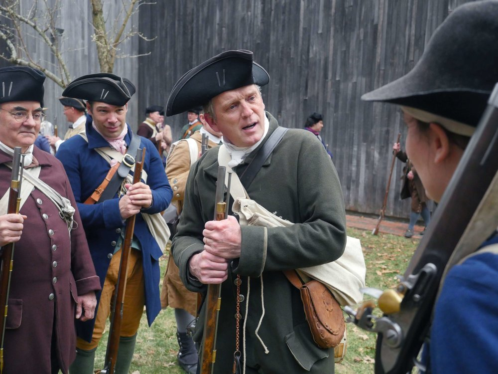 Lincoln, MA - April 14th, 2018 - Sergeant Major of the Lincoln Minuteman Company Hannes Klein hands out orders to reenactors participating in the Battle of Lexington and Concord battles. All men between 16 and 60 in the colonies were expected to be apart of the militia during the Revolutionary War.