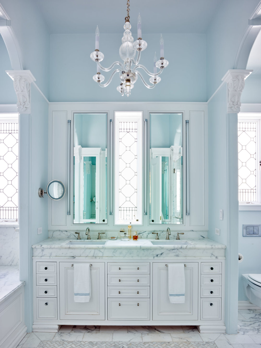 The restfully symmetrical new master bath featuring stained glass windows. Renovated historical house in San Francisco. Stained glass windows by Victoria Balva