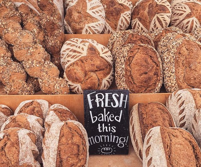 We really can't think of anything better than taking home a warm loaf of bread from the farmers market. Fresh, flavorful, sourdough bread, granola, and ferments are here at the @brightonfarmers outdoor market every Sunday!  #artisanbread #sourdough #sourdoughbread #naturallyleavened #painaulevain #local #organic #brightonny #rochesterny #brightonfarmersmarket #knowyourbaker #knowyourfarmer