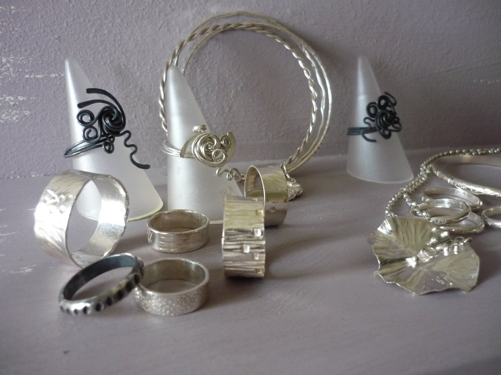 workshop shelf with jewellery.JPG