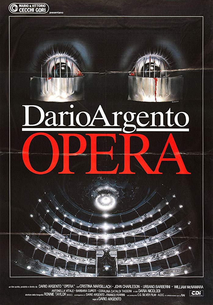 Opera (1985) - Directed by: Dario ArgentoStarring: Cristina Marsillach, Ian Charlson, Urbano BarberiniRated: R for Strong Terror and Violence, and a Scene of SexualityRunning Time: 1 h 47 mTMM Score: 4 stars out of 5STRENGTHS: Directing, Atmosphere, PacingWEAKNESSES: Dialogue, Plot Holes (?)