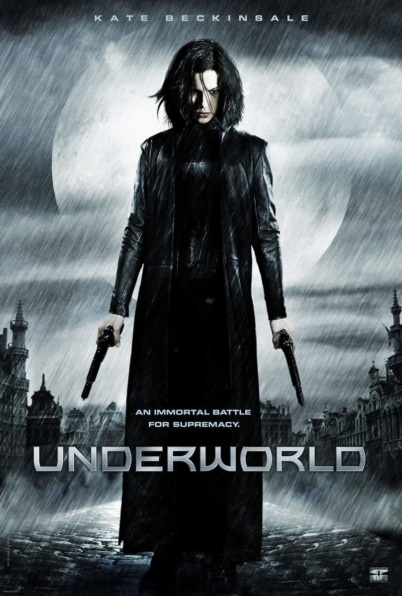 Underworld (2003) - Directed by: Len WisemanStarring: Kate Beckinsale, Scott Speedman, Michael Sheen, Bill Nighy, Shane BrollyRated: R for Strong Violence/Gore and Some LanguageRunning Time: 2 h 1 mTMM Score: 2.5 stars out of 5STRENGTHS: Action, Creature Design, World Building, Some Visual EffectsWEAKNESSES: Pacing, Expositional Dialogue, Some Acting, Some Visual Effects, Early 2000s Cool