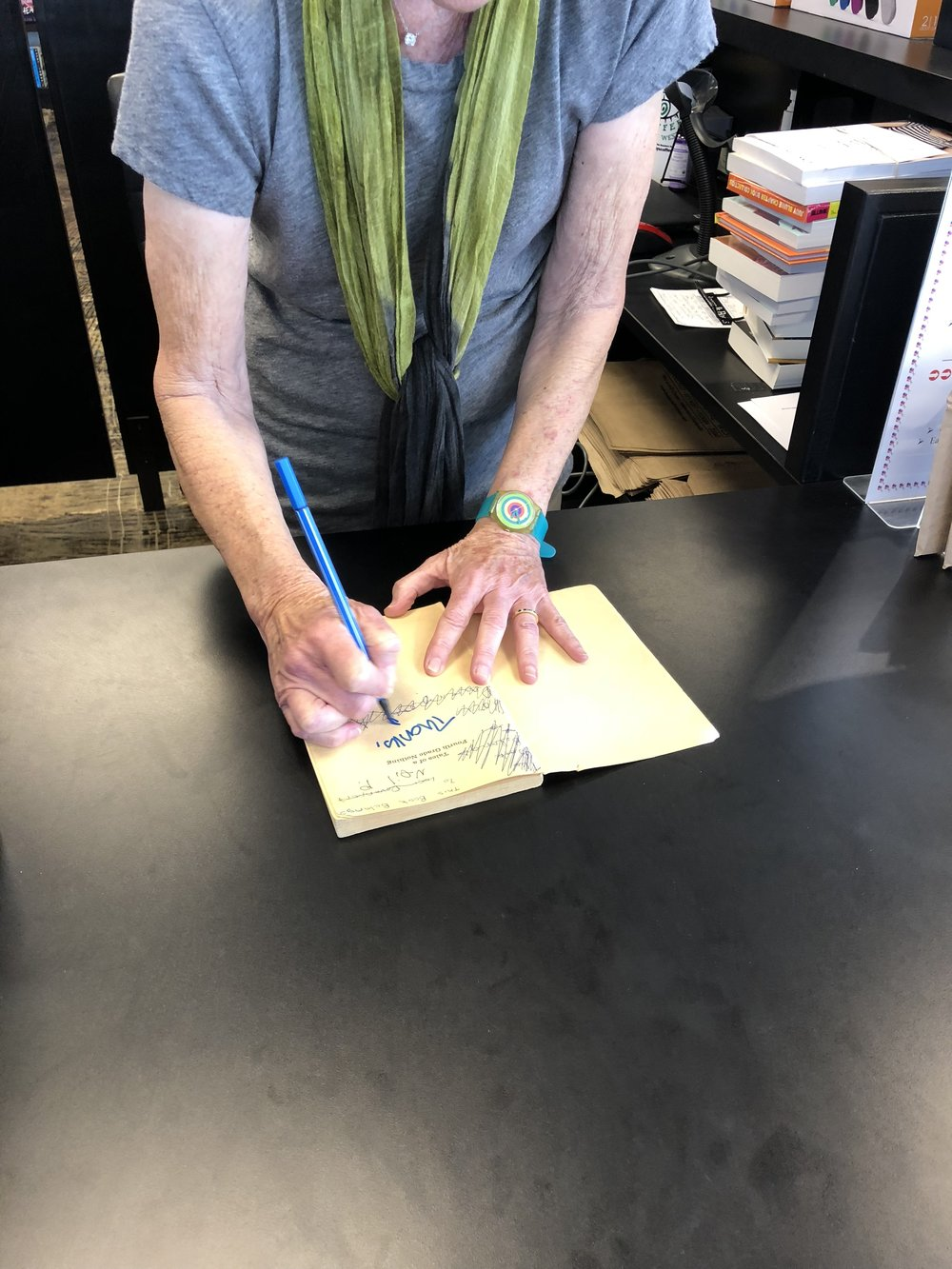 Judy signing said old, tattered copy