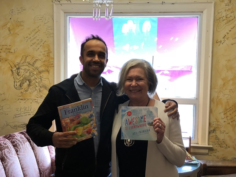 Me, Paulette, and our children's books. I have sold approximately 59 million less books than her!