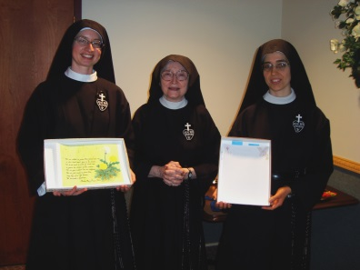 Sr. Cecilia Maria and Sr. Maria Andrea present their gifts of a poem by Mother Mary Francis PCC and homemade stationery
