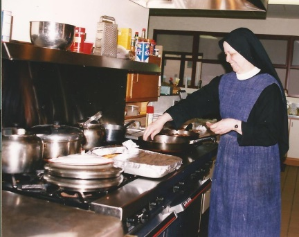 Sr. Mary Dolores cooking a meal  for the community.  Mmm..maybe she was frying some chicken  for a nice Sunday feast!