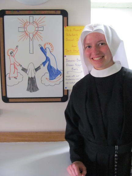 The marker board representing St. Francis of Assisi, Sr. Frances Marie and Our Lady Assumed into Heaven. Sr. Frances Marie's holy patrons will teach her how to love the Eucharistic Heart of Jesus and how to be eucharist to others
