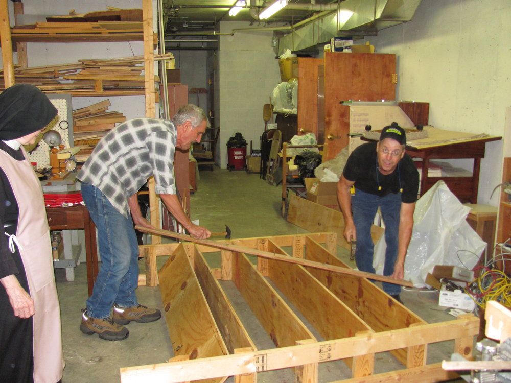 Dwayne and Mike volunteer to build shelving for the Nuns