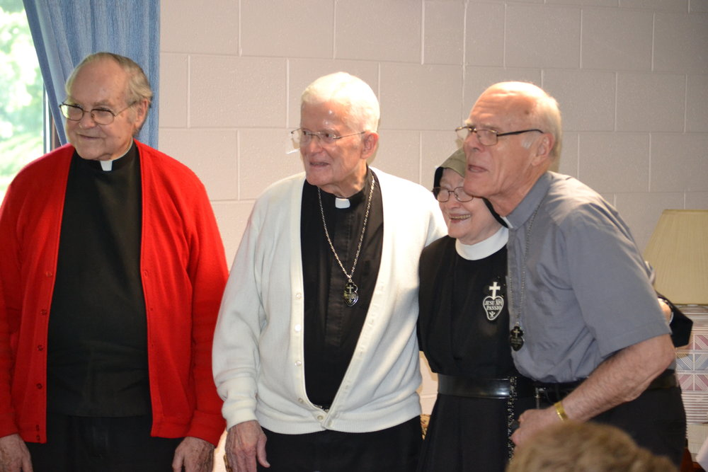 Oblate clergy with Sr. Catherine Marie
