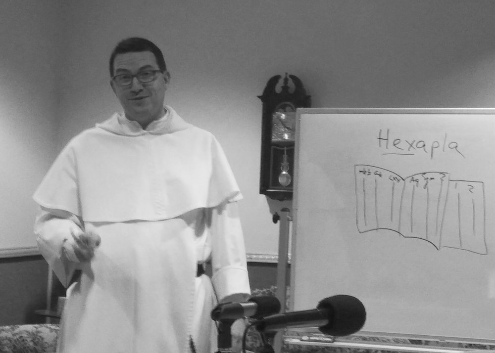 Fr. Austin in action with his whiteboard marker, explaining Origen's Hexapla critical edition of the Old Testament.