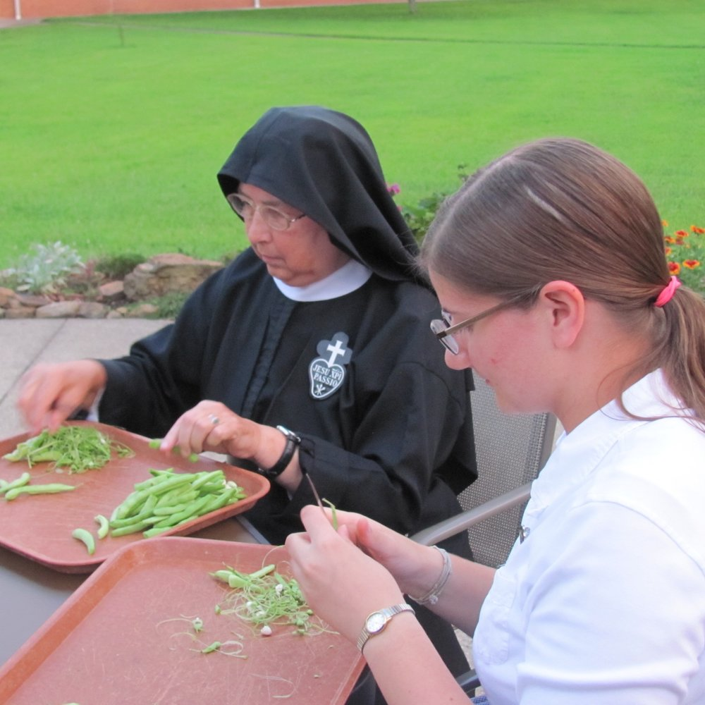 Sr. Mary Therese is a quick worker - the camera-nun caught her hands in action!