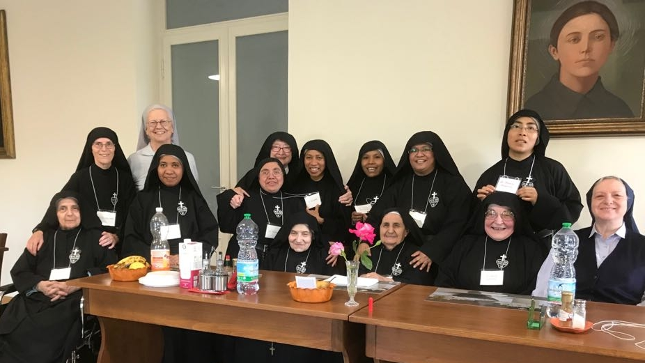 Mother Catherine Marie with some members of the Monastero di Santa Gemma in Lucca, Italy.  Also pictured are Sr. Joan Mary Topor, CP (an active Passionist and Mother Catherine Marie's translator) and Mother Fernanda Barbiero, smsd, General Delegate of the Holy See for the Passionist Nuns.
