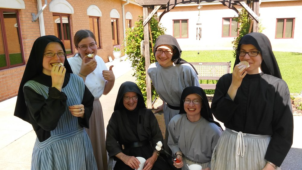 Sr. Frances Marie, Theresa, Sr. Mary Veronica, Sr. Lucia Marie, Sr. Cecilia Maria, and Sr. Maria Faustina enjoying some 4th of July s'mores