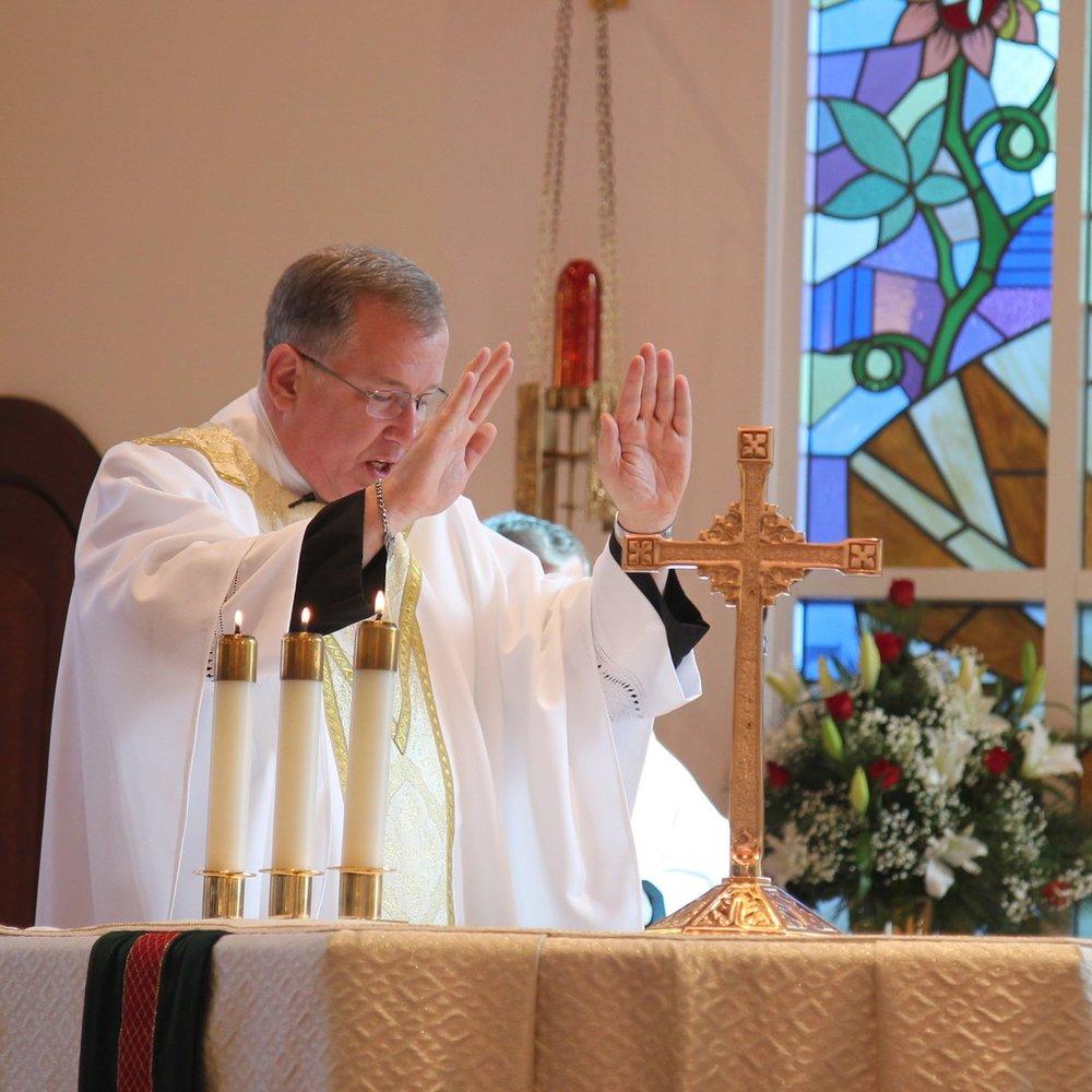 Fr. David Wilton, CPM, prays the solemn consecration over Sr. Cecilia Maria.