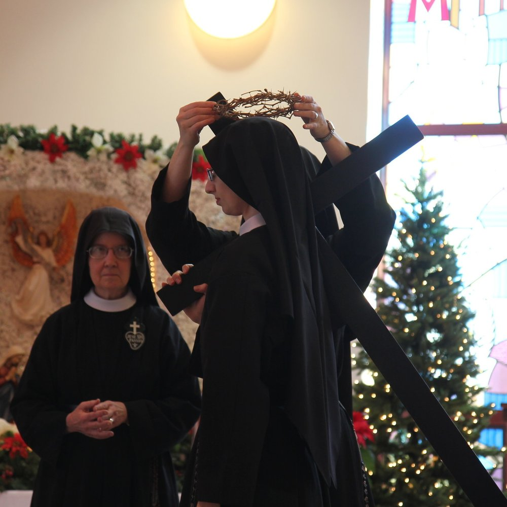 Sister receives the cross and crown of a bride of Jesus Crucified.