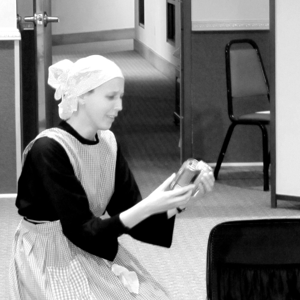 Isabel as Pacifica, the Possenti family's maid, packing Gabriel's things for his entrance to the Passionists.
