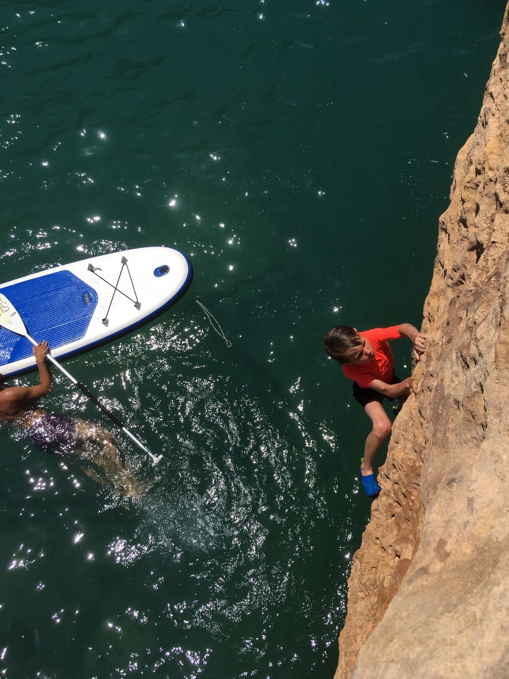 Free soloing over the water.