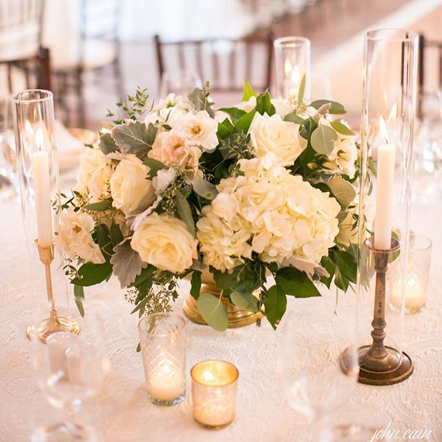 Welcome your guest to a beautiful dining table with lush hydrangea, garden rose and spray rose centerpieces accented with candles galore!  Wedding Planner @imoni_events | Venue @silverleafclub | Photography @johncainsargent | Floral & Furniture Vignettes @flowerstudio | Entertainment @string.serenade @trejavu @tracycelaya | Cinematographer @serendipitycinema | Paper Goods @southernfriedpaper | Cake @abakeshop |  Glam Squad: @laura_flagler ..#flowerstudioaz #azflorist #azweddings #weddingflowers #weddingflorist #luxurywedding #weddingsinthedesert #bride #arizona #customfloraldesign #customweddings #itsallinthedetails #weddingseason #style #photooftheday