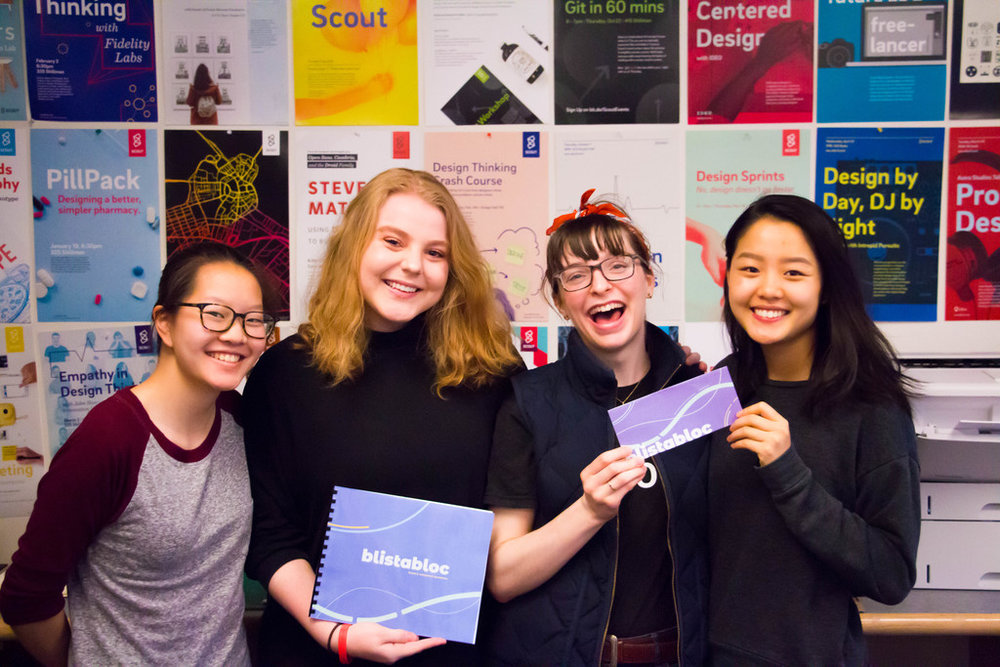 Our POWER GIRL TEAM!!! With our final branding booklet and prototype. From left to right: Brittany (developer), Sarah (graphic designer/illustrator), Olivia (project lead & UI/UX designer), me (UX/UI Designer)