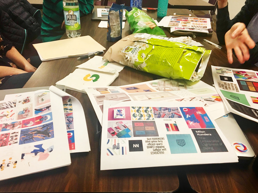 Examining moodboards at client meeting.