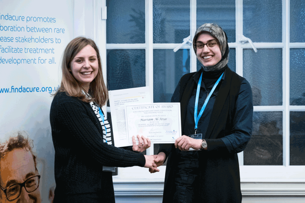 Photo of Mariam receiving her essay prize at The Findacure Drug Repurposing Conference 27th February 2018.