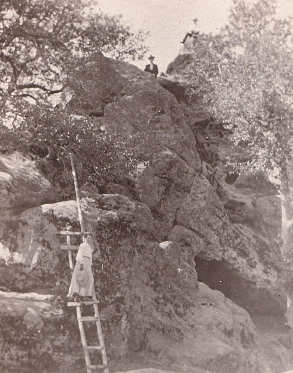 Victorian-Era Climbing - Visitors to Castle Rock in the 19th century use a ladder to access the top of the monoliths.