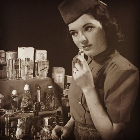 This is one of the many very cool vintage images hanging around the CR offices. I think she is testing perfume.