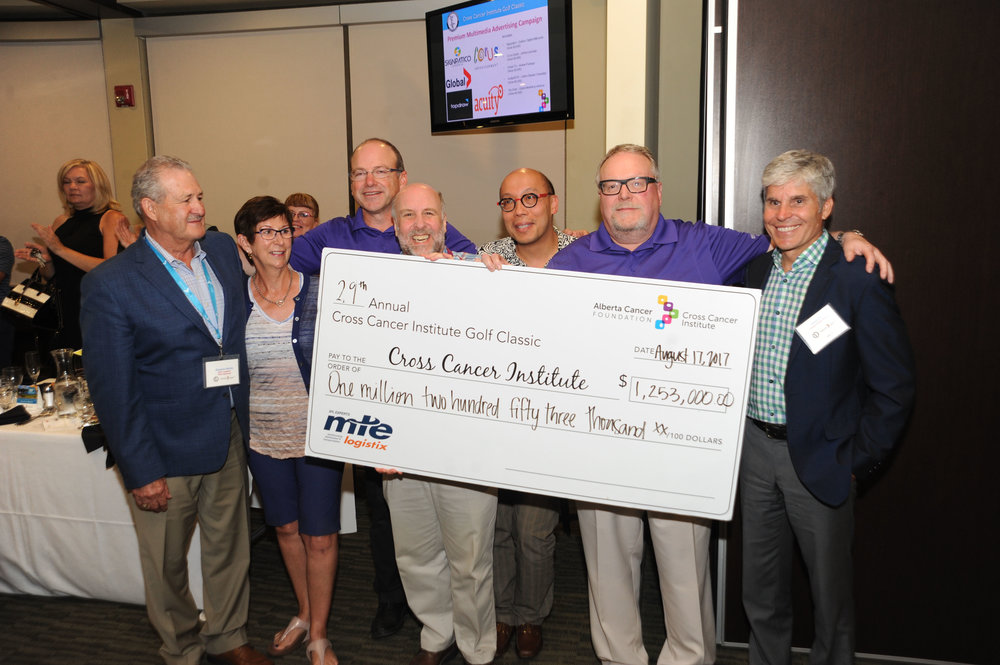 __Cheque Presentation with Drs _ Chairs of Tourney.jpg