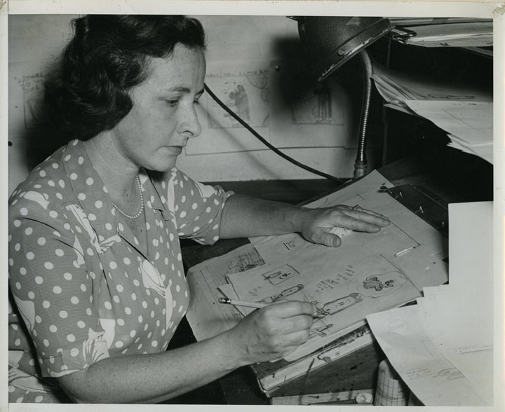 Buell at the drawing board drawing Lulu in Paramount's New York studios, but other than drawing character models, she had no part in creating the animation or the storylines.