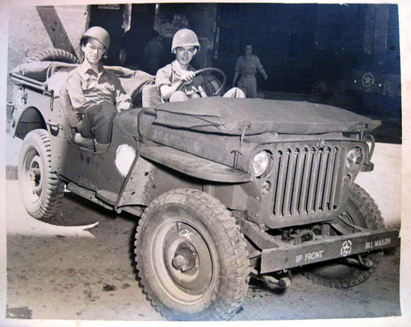 Gregor Duncan and Bill Mauldin in a Jeep (click to enlarge)