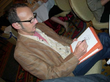 Dan draws a sketch at an association meeting.