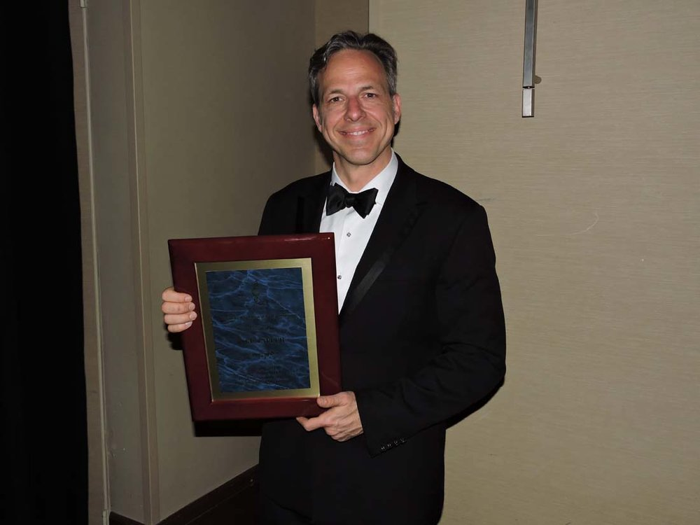 tapper-with-plaque.jpg