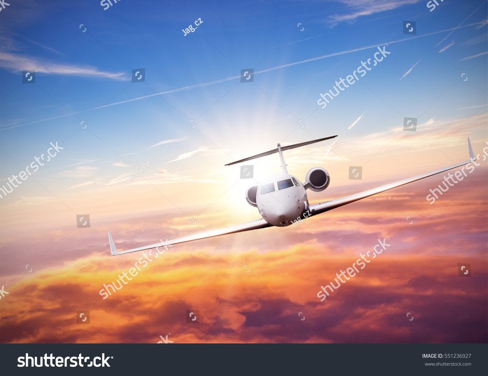 stock-photo-private-jet-plane-flying-above-clouds-in-beautiful-sunset-shot-from-front-view-high-resolution-551236927.jpg