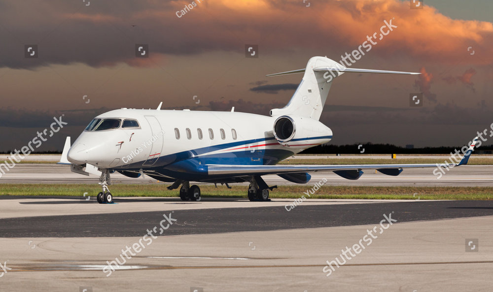 stock-photo-private-jet-on-the-runway-307454687.jpg