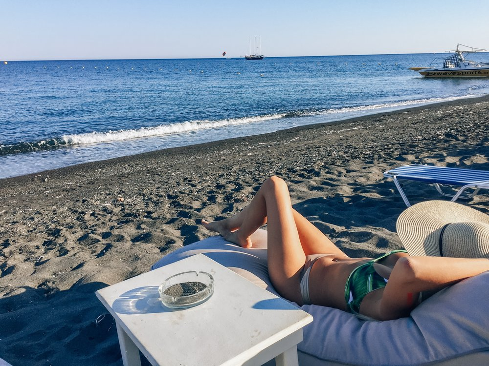 santorini perivolos beach black sand greece