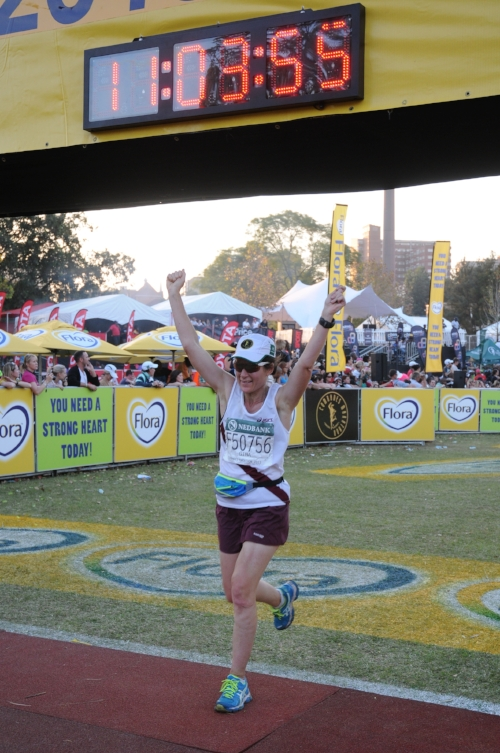 Gina finishing 91.1km, and somehow having fun!