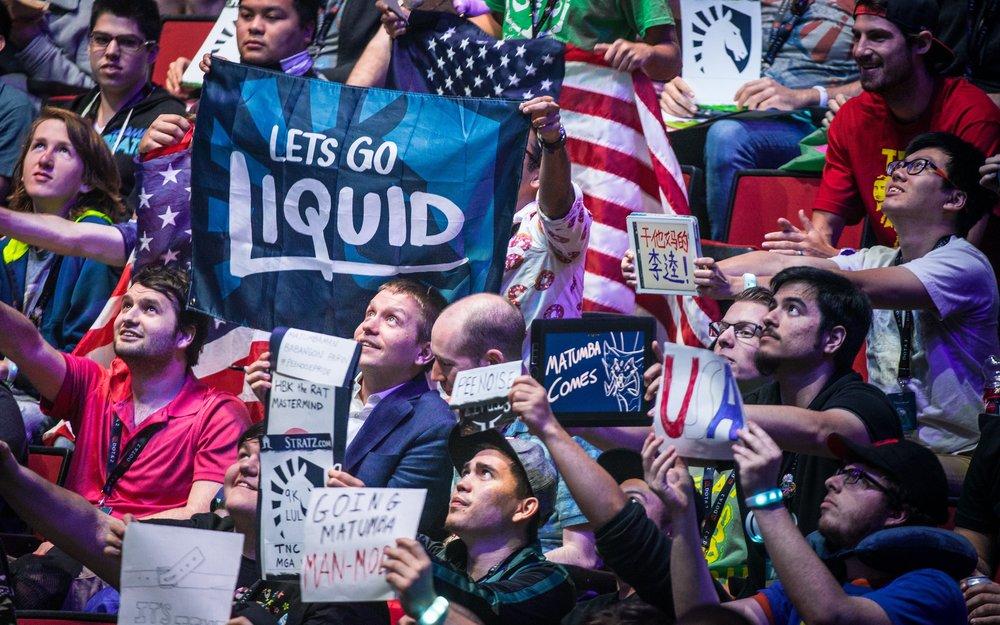 Team Liquid fans cheer at The International 7, a Dota 2 tournament.