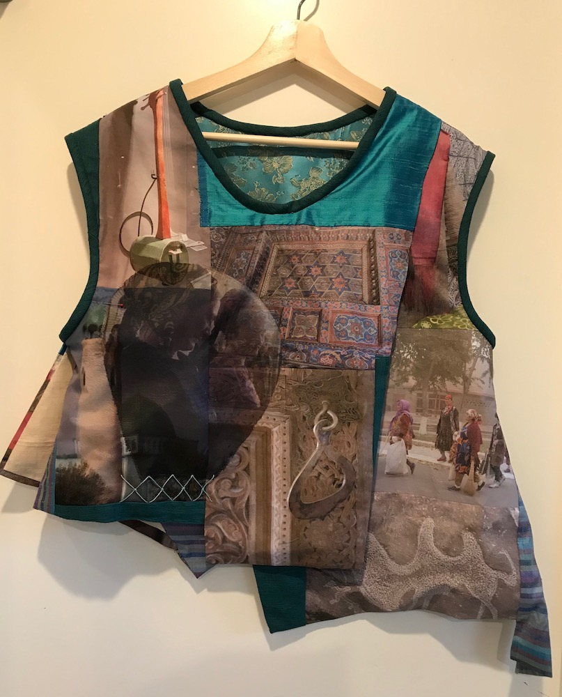 "Susanne C Scott  infotectives@gmail.com  Memories of the Silk Roads 36""x30""x6"" NFS but will accept comissions  This vest is a collage of photographs taken on my Silk Roads adventure digitally printed on silk and cotton assembled, with other silks and brocades, into a wearable garment. While this piece is my personal memory of this adventure, I am very interested in building a similar wearable garment for other adventurers or memorists."