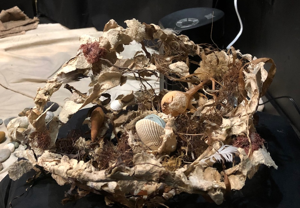 Seaweed Nest and Clamshell Book  Jean-Marie Tarascio jmtarascio@gmail.com  jmtarascio.com  NFS  Wire Nest Sculpture covered in handmade paper and found natural objects. Book pages are in a clamshell.