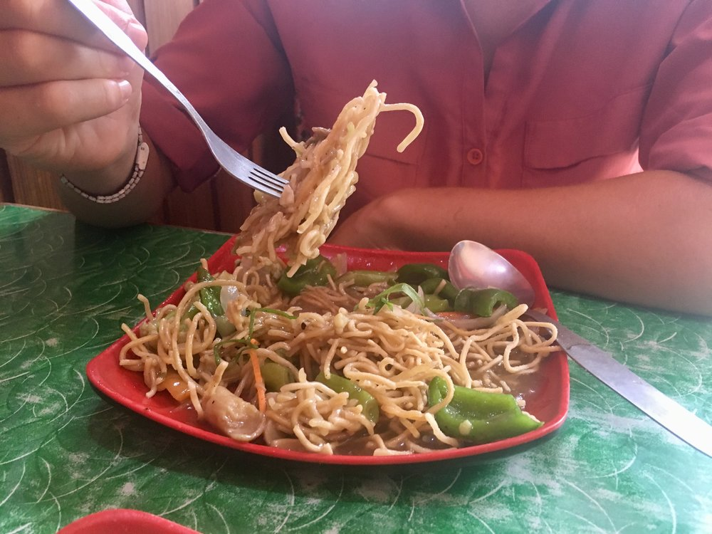 We had the most bizarre lunch when we were wandering around Kathmandu. It called itself 'chopsuey', but it was definitely not what Google describes as chopsuey. Basically, this was a packet of super noodles,  uncooked , topped with vegetables and gravy.  The noodles were crunchy!
