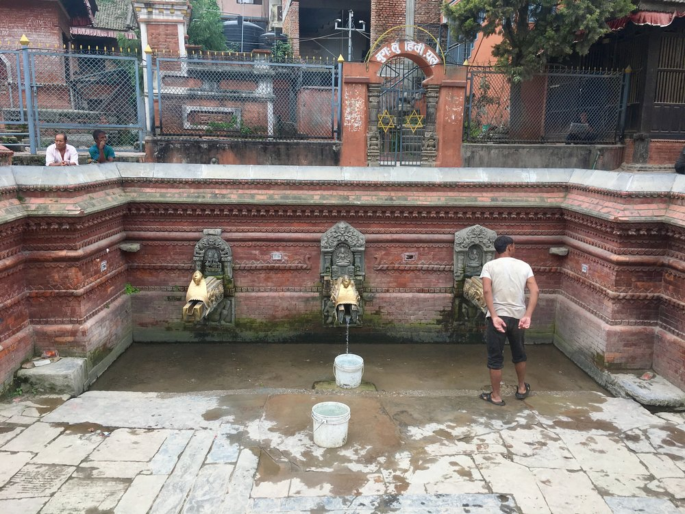 (Patan) When there's no running water, people turn to these public water supplies.