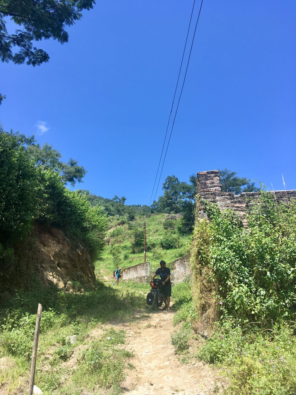 If you remember, the road to Shivapuri Heights Cottage was closed due to a landslide, and we had to use a hiking trail to get there. Well, as you'd expect, going down was much easier than going up. The bikes pretty much walked themselves.