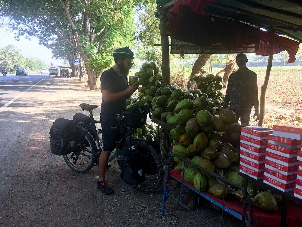 A quick coconut stop. So quick, Dan didn't even get off his bike.