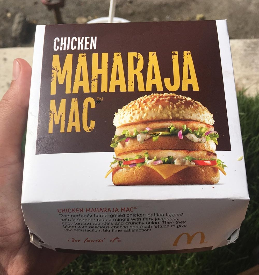 Here's something for ya – since Hindus don't eat beef, and they make up most of the population, you never see beef on the menu here in India. McDonald's has clocked onto this and adapted to the Indian market by only selling chicken burgers. They've also recreated the Big Mac as a Chicken Big Mac, aka Chicken Maharaja Mac. Let me tell ya, it's no Big Mac. There's no classic burger sauce and it's spicy. Also, it's  chicken !