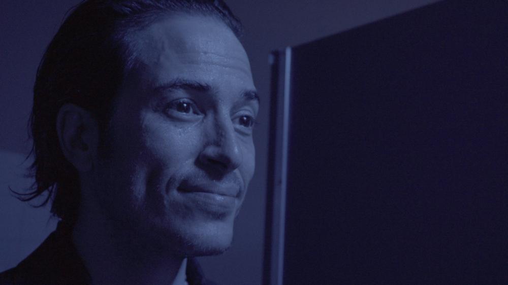Viggo (Adam Graziano) stares in the mirror.