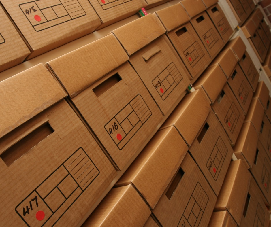 boxes-of-company-records-in-archives-room-picture-id139737417.jpg